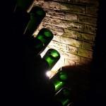 Bouteilles sur pupitres dans les caves Pommmey à Reims